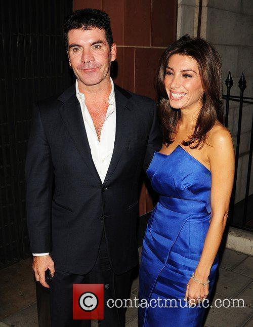 Simon Cowell and Mezghan Hussainy outside C restaurant...