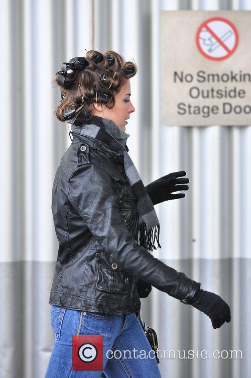 Gemma Atkinson with her hair in rollers outside...