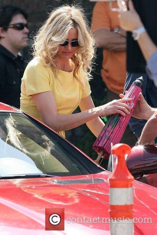 Cameron Diaz getting into a Mercedez while filming...
