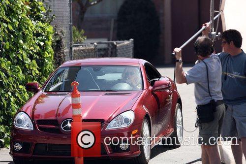 Cameron Diaz driving a Mercedez while filming a...