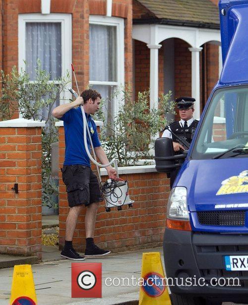 Removal men outside Prime Minister David Cameron's house...