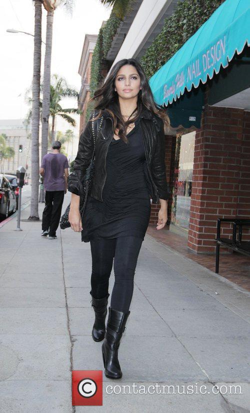 Camila Alves  walks to a medical building...