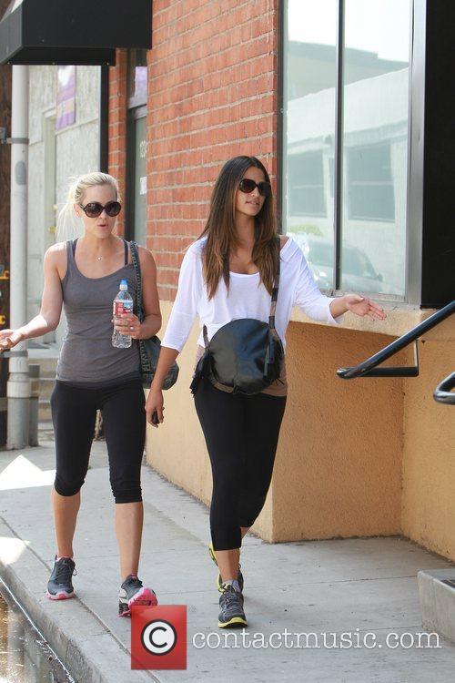 Camila Alves with a friend outside a gym...