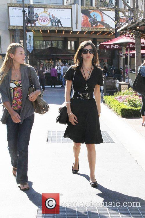Camilla Belle, wearing an all black ensemble, shopping...