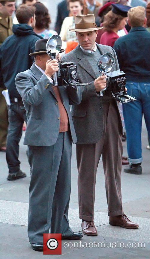 Extras dressed as photographers during the filming of...