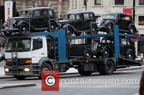 Vintage cars are delivered to Trafalgar Square during...