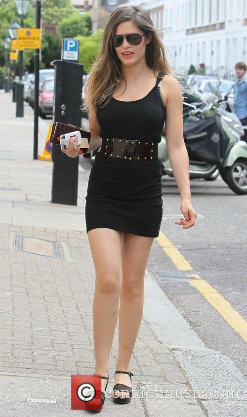 Walking in Central London, wearing a short black...