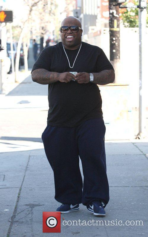 Cee Lo Green holding on to a handful...
