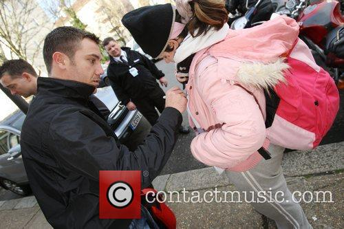 Gino D'Acampo stops to sign an autograph for...