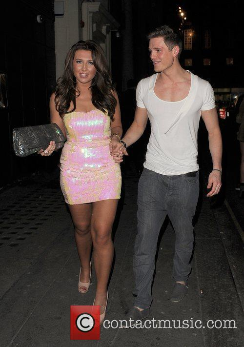 Lauren Goodger leaving Chinawhite nightclub with a male...