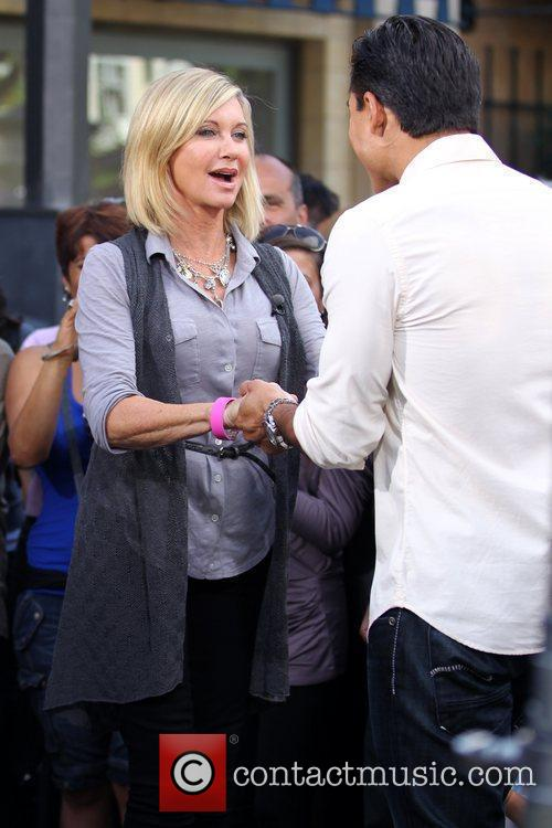 Olivia Newton-John filming an interview for the entertainment...