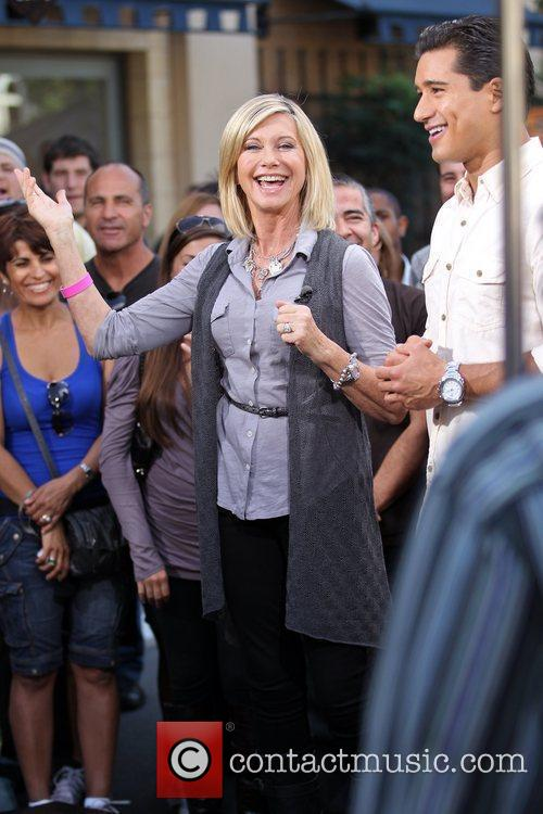 Olivia Newton-John filming an interview with Mario Lopez...