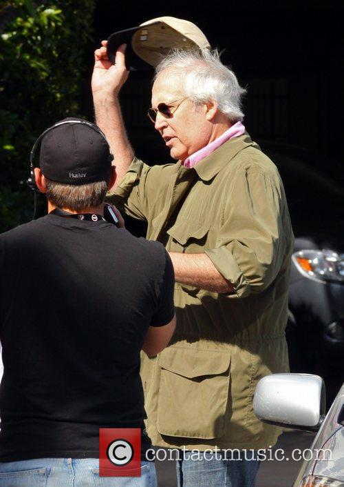Chevy Chase filming an interview for the entertainment...