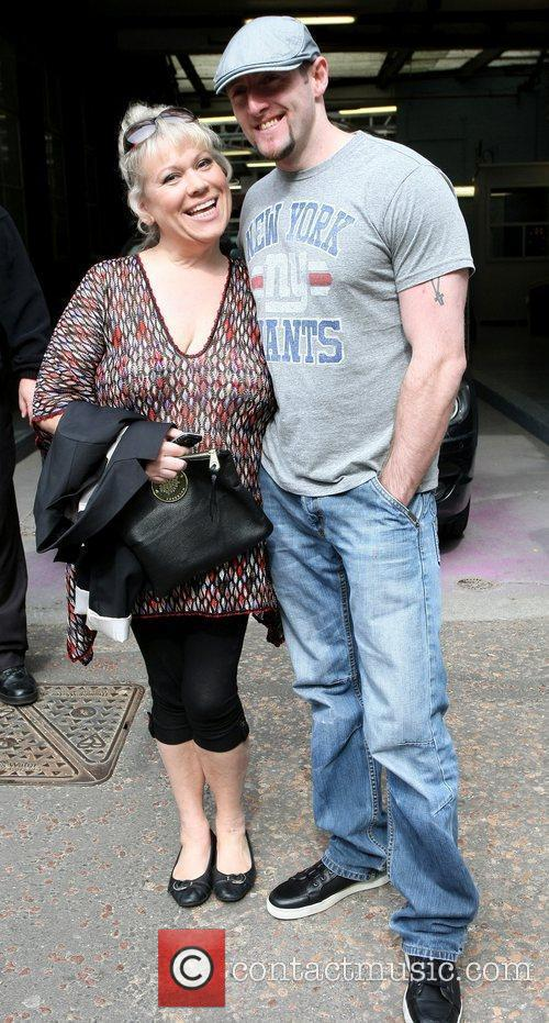Tina Malone and her fiance Paul Chase outside...