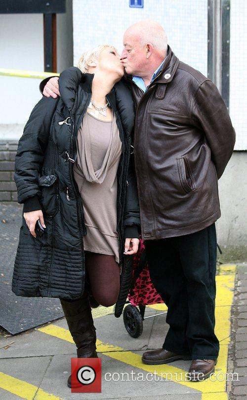 Denise Welsh and Tim Healy kissing Celebrities outside...