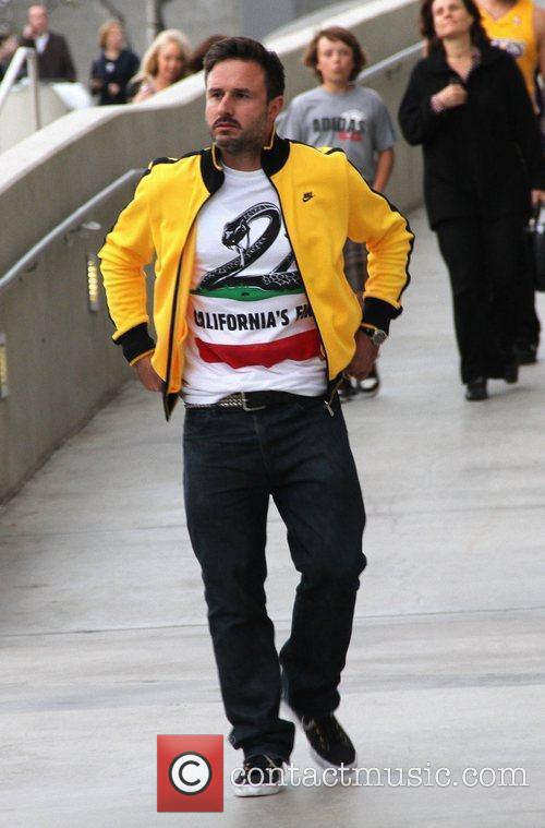 David Arquette Celebrities arrive at the Staples Center...
