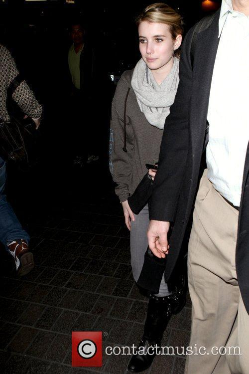 Arriving at LAX airport while wearing a grey...