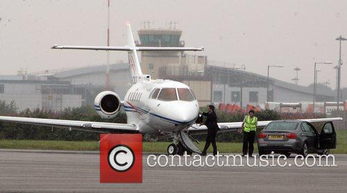 Paul McCartney's private jet waits for him while...