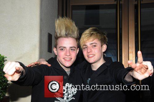 John and Edward Grimes, aka Jedward, pose for...