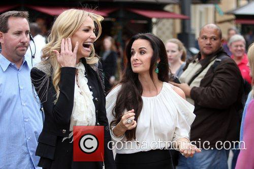 Taylor Armstrong and Kyle Richards filming an interview...