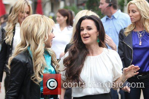 Adrienne Maloof and Kyle Richards  filming an...