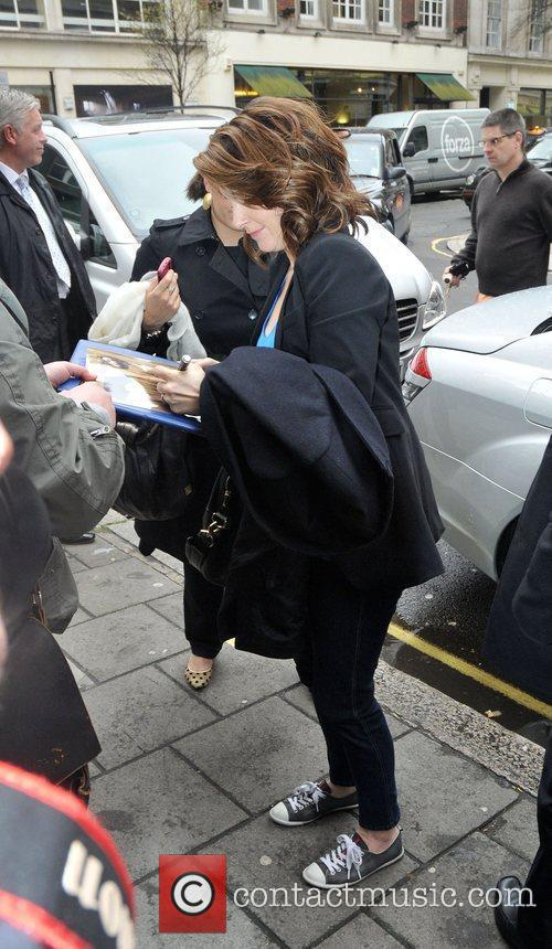 Tina Fey signs autographs outside the Radio One...