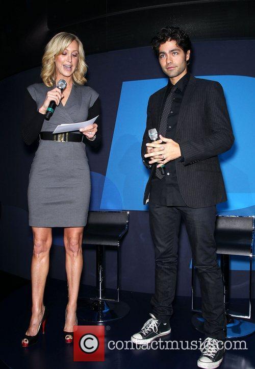 Lara Spencer and Adrian Grenier on the Blackberry...