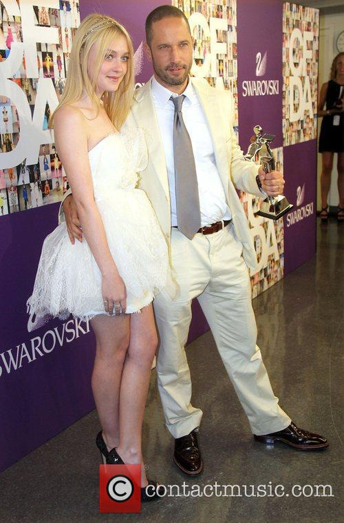 Dakota Fanning and Accessory Alexis Bittar attend the...