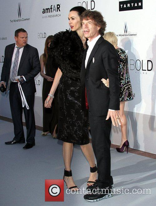 Mick Jagger and guest 2010 Cannes International Film...