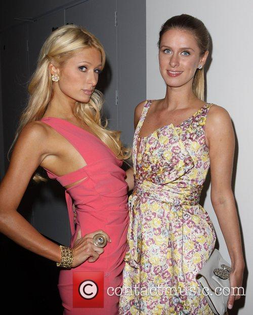 Paris Hilton and Nicky Hilton Fashion Designer Gilbert...