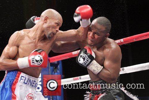 Boxer Joan Guzman  earned a 12-round split...