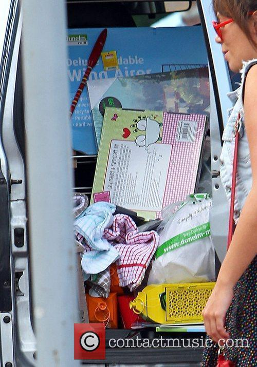Charlotte Church fills her car with purchases after...
