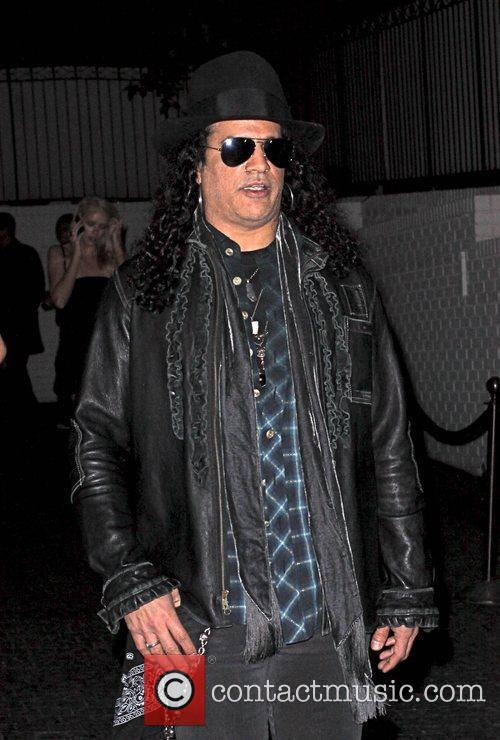 Slash arriving at pre-Oscars party at Chateau Marmont...