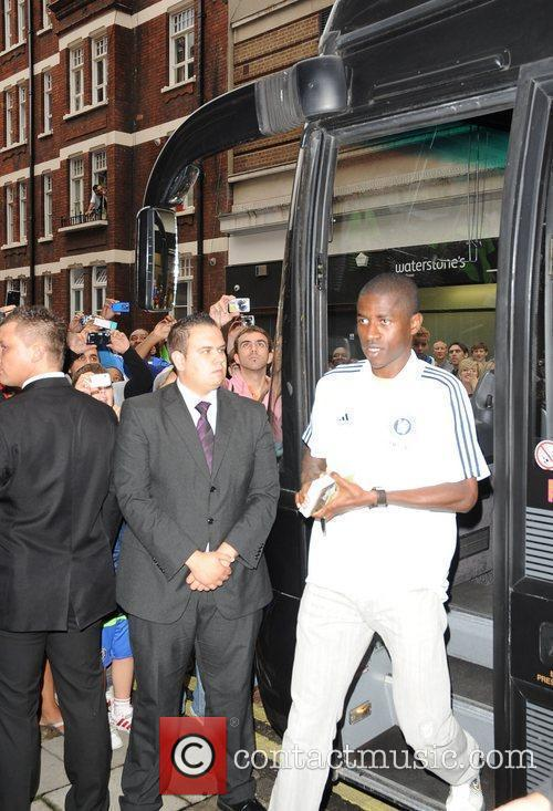 Chelsea football players arriving at the Adidas store...