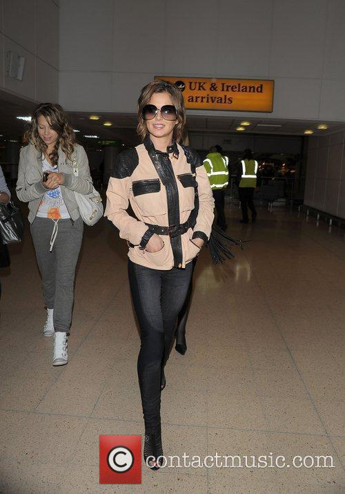Cheryl Cole arriving at Heathrow airport after flying...