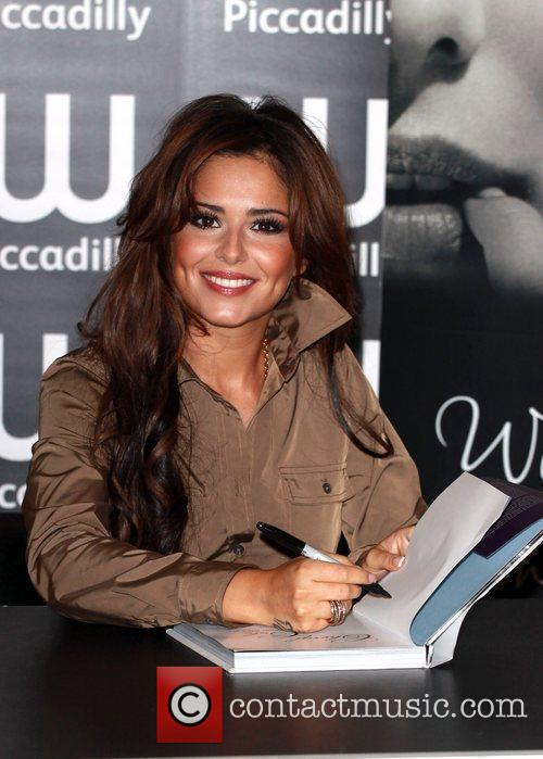 Cheryl Cole  signs copies of her book...