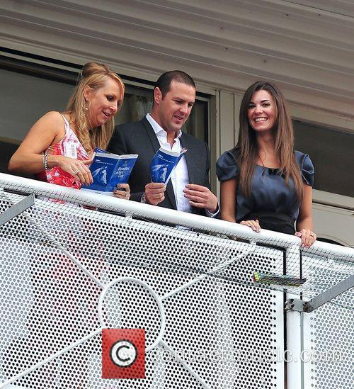 Watching the horse racing on ladies day at...