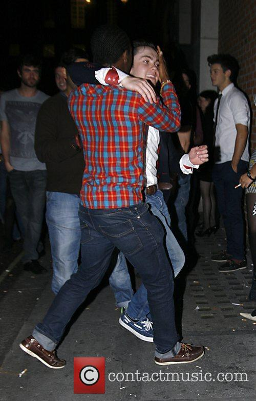 Ray Quinn outside Chinawhite nightclub with a friend...