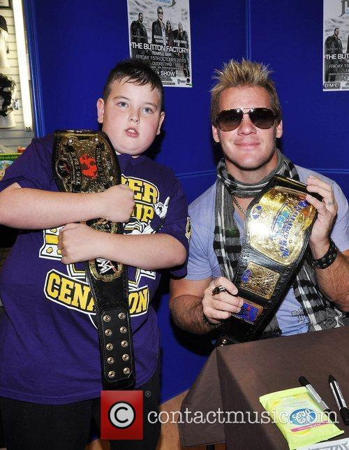 WWE Superstar Chris Jericho signs copies of his...