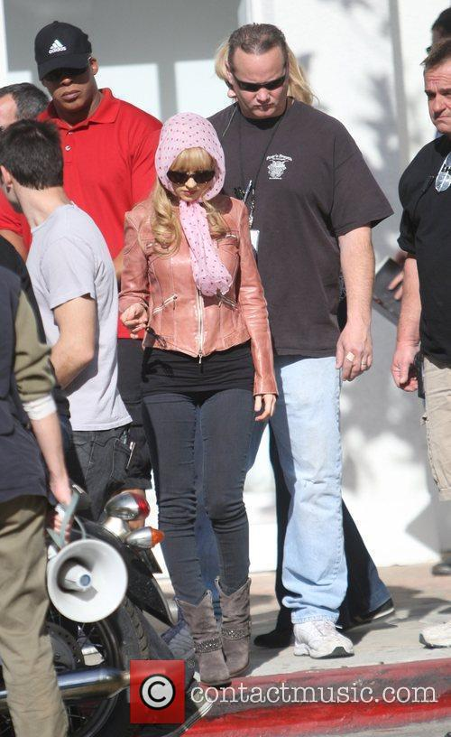 Christina Aguilera wearing a pink headscarf on the...