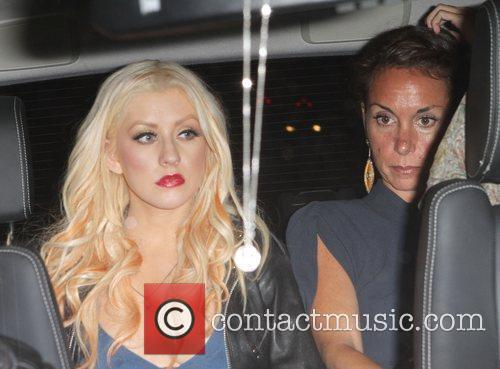 Christina Aguilera is seen leaving BOA Steakhouse with...