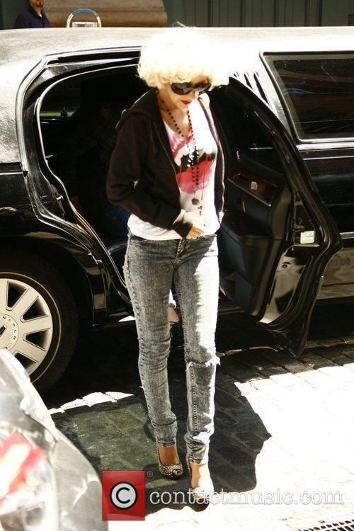 Arriving back at her hotel surrounded by paparazzi,...