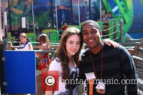 Christopher Massey and Brittany Curran volunteer at the...