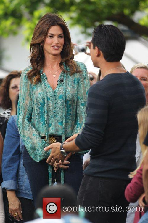 Cindy Crawford films an interview with Mario Lopez...