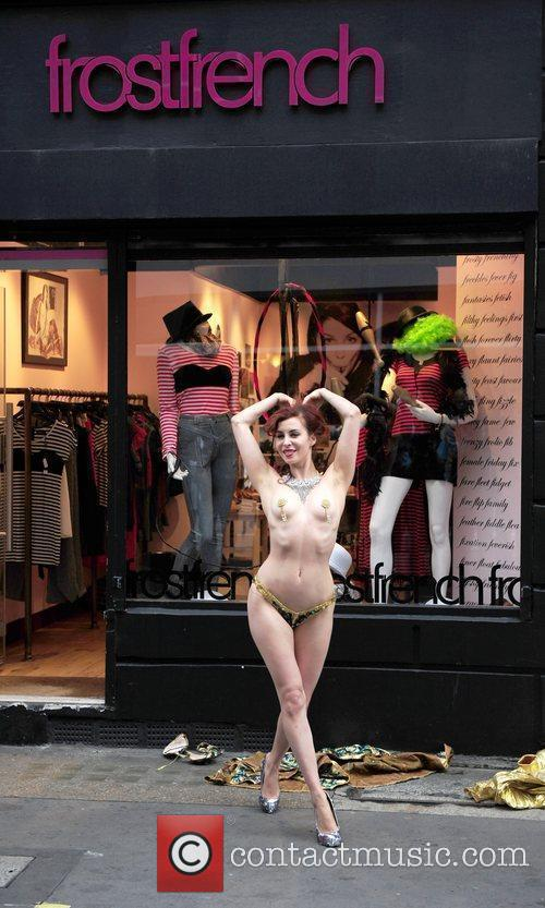 A Burlesque Performer Dances Outside The Cirque Du Frostfrench Party At The Frostfrench Store 11