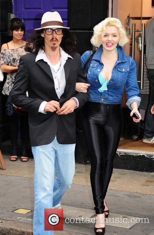 Johnny Depp and Marilyn Monroe lookalikes outside the...