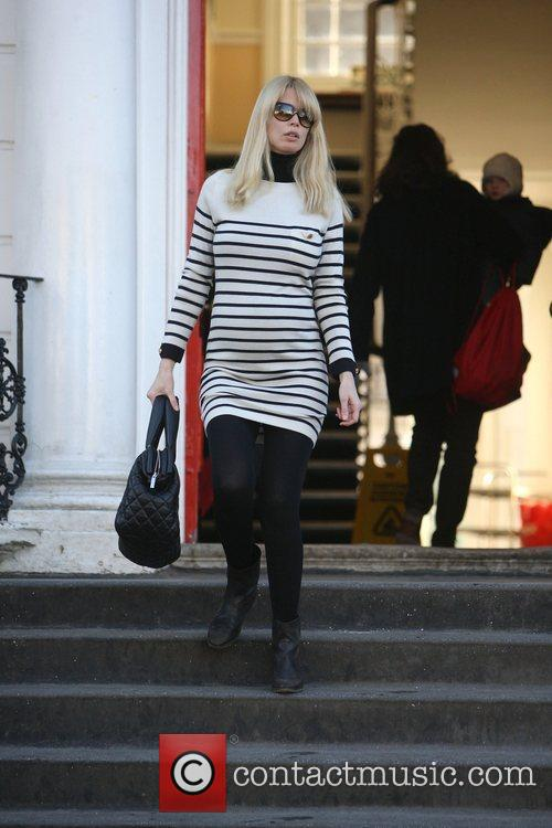 A pregnant Claudia Schiffer making her way home...