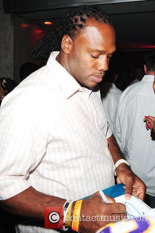 Free agent Zack Crockett signing autographs at Club...