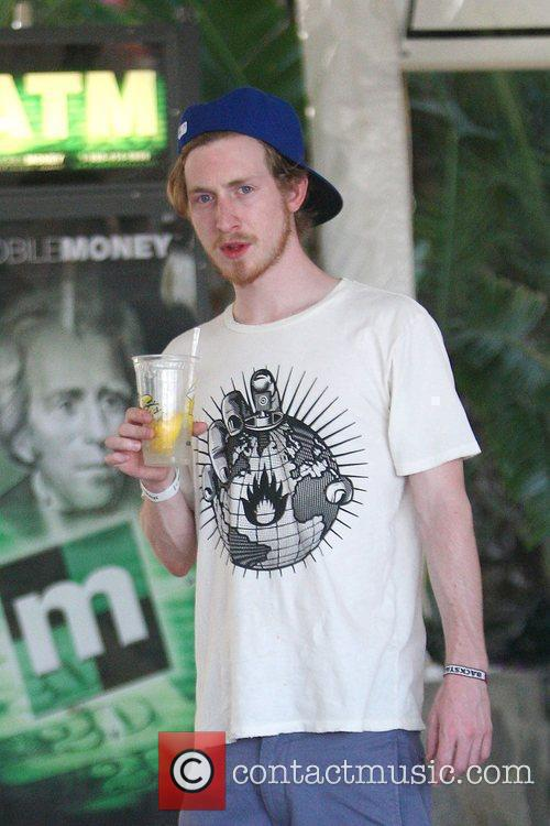 American rapper Asher Roth cools down with a...