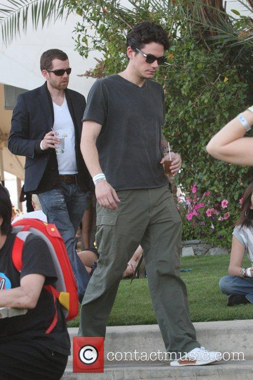 John Mayer carrying a drink at the 2010...